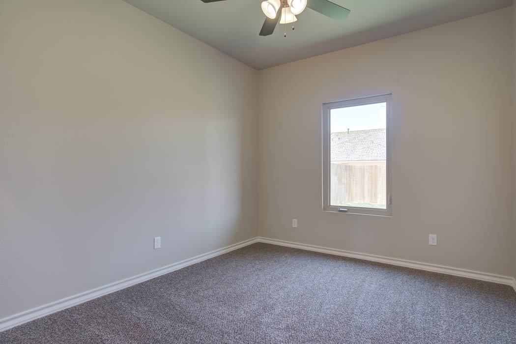 Guest bedroom in new Lubbock home for sale.