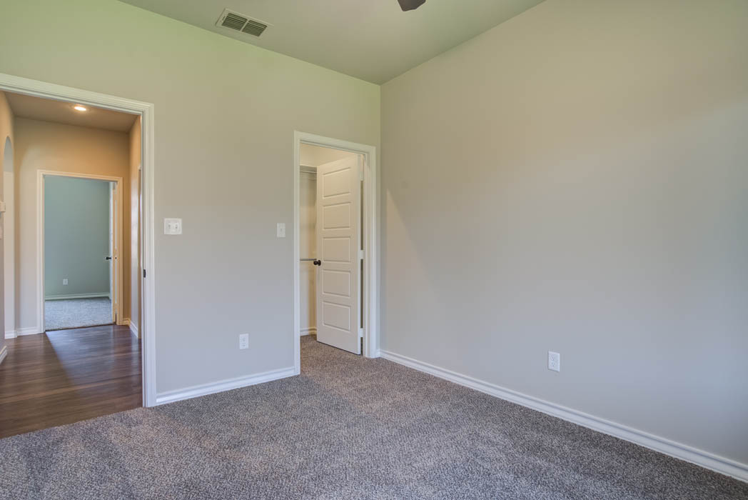 Guest bedroom in new home for sale in Lubbock.