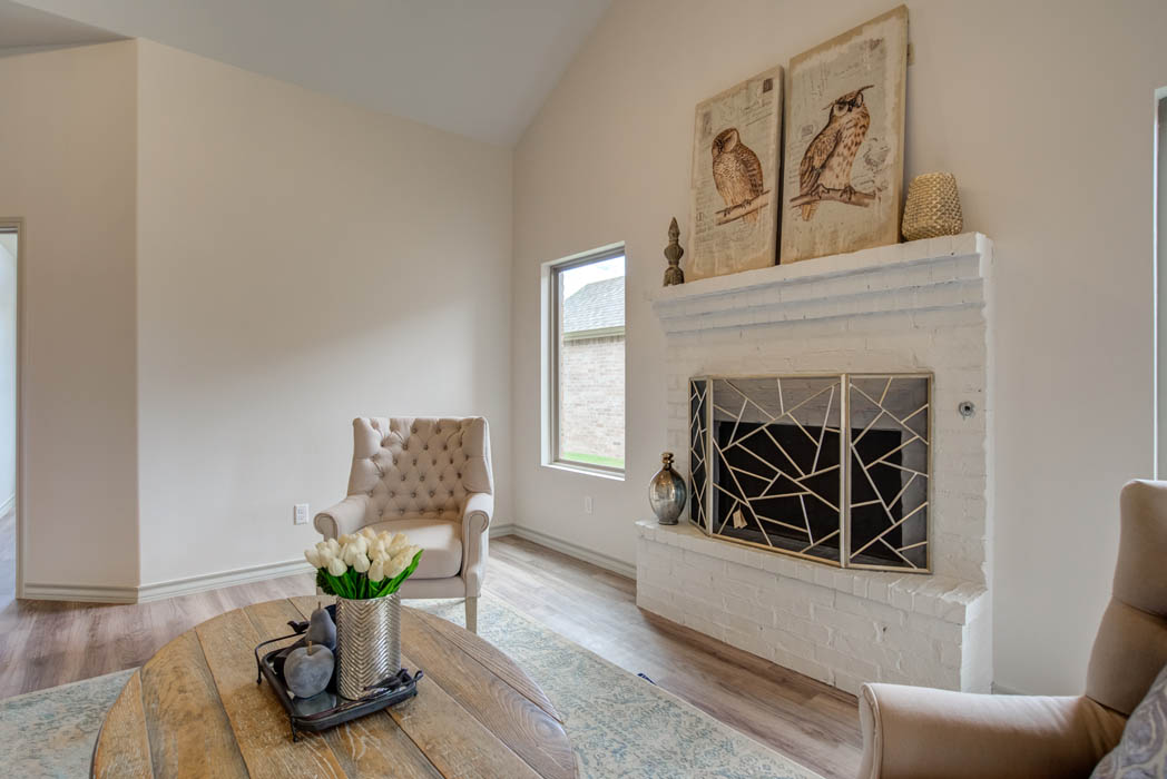 Fireplace in living area in new home for sale in Lubbock, Texas.