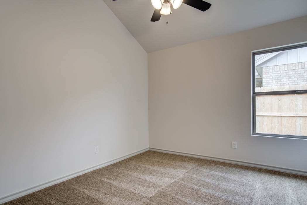 Spacious bedroom in new home for sale in Lubbock, Texas.