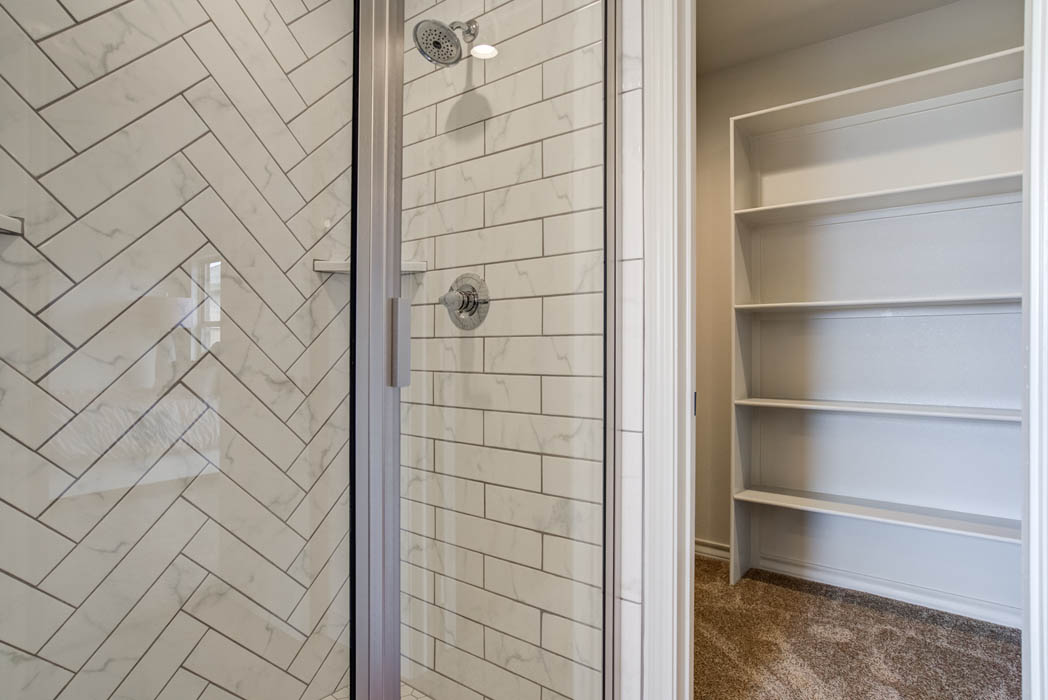 Detail of shower tile in master bath in new home for sale in Lubbock, Texas.