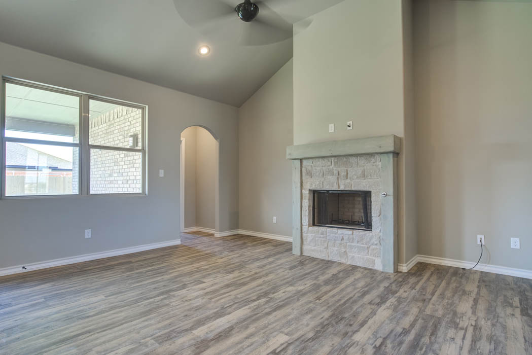 Spacious living area in new home for sale by Sharkey Custom Homes.