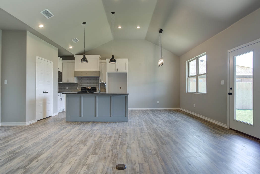 View of spacious living area looking towards kitchen in new home for sale in Lubbock.