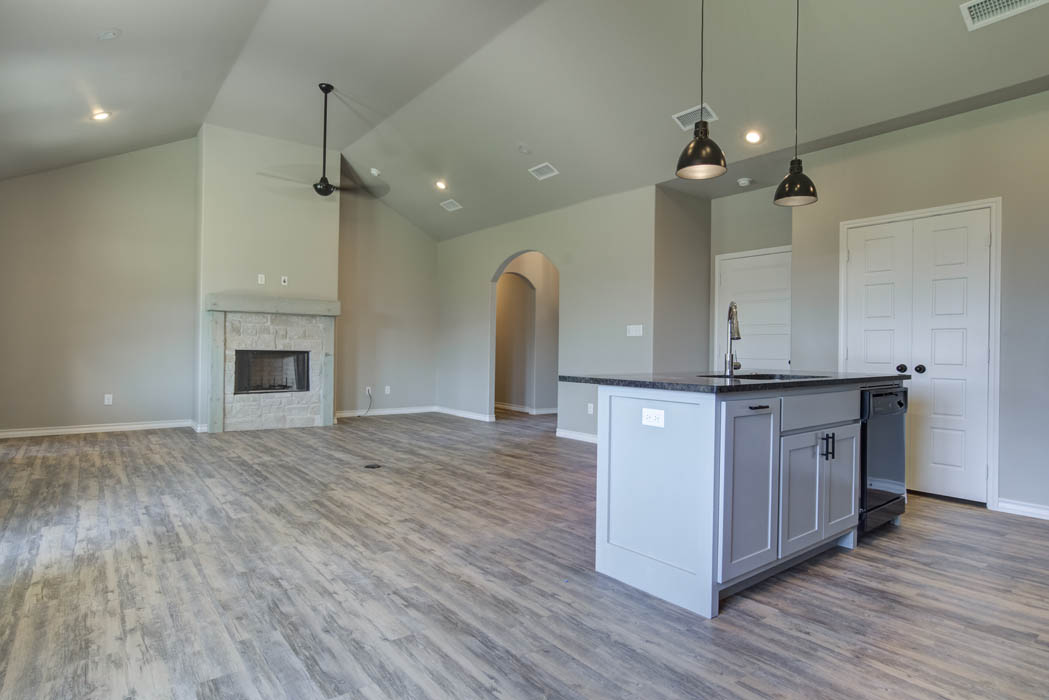 Island/bar in kitchen of new home for sale in Lubbock.
