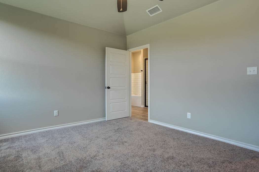 Bedroom in new home for sale in Lubbock, Texas by Sharkey Custom Homes.