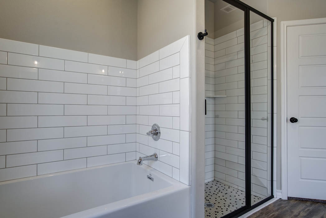 Tub shower in beautiful master bath of new home for sale in Lubbock.