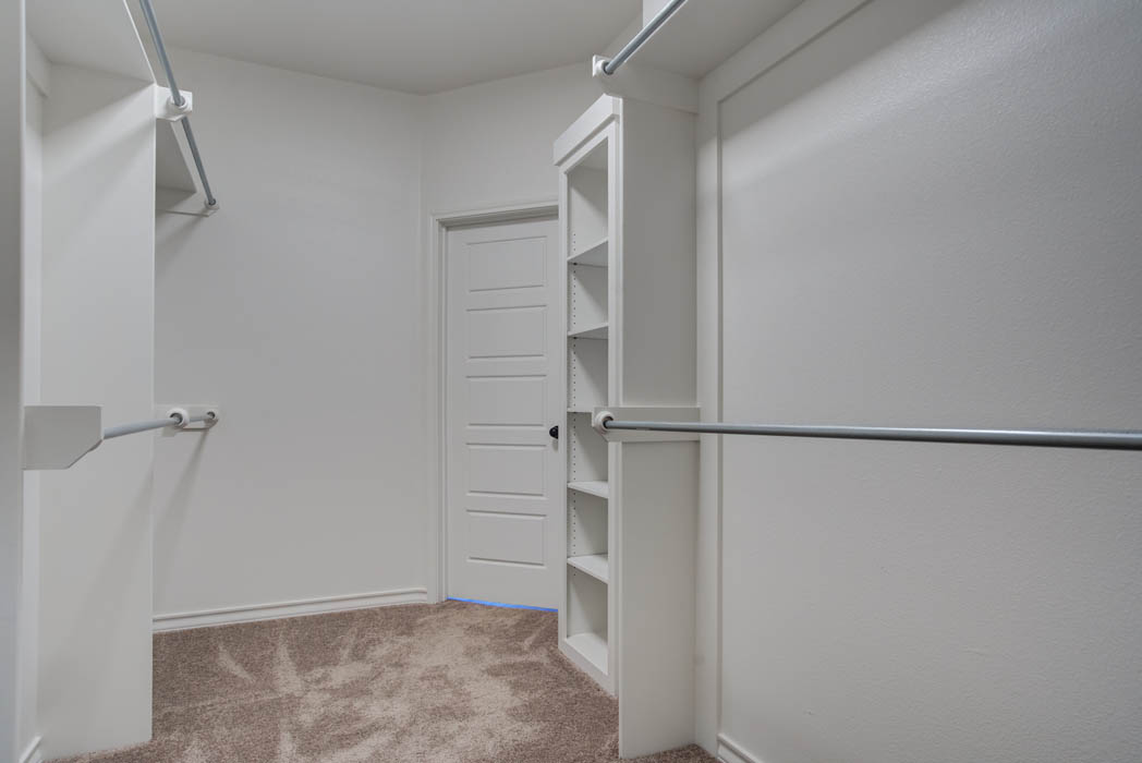 Spacious master closet in new home for sale by Sharkey Custom Homes.