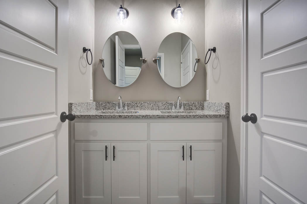 Beautiful guest bathroom in new home by Sharkey Custom Homes in Lubbock, Texas.