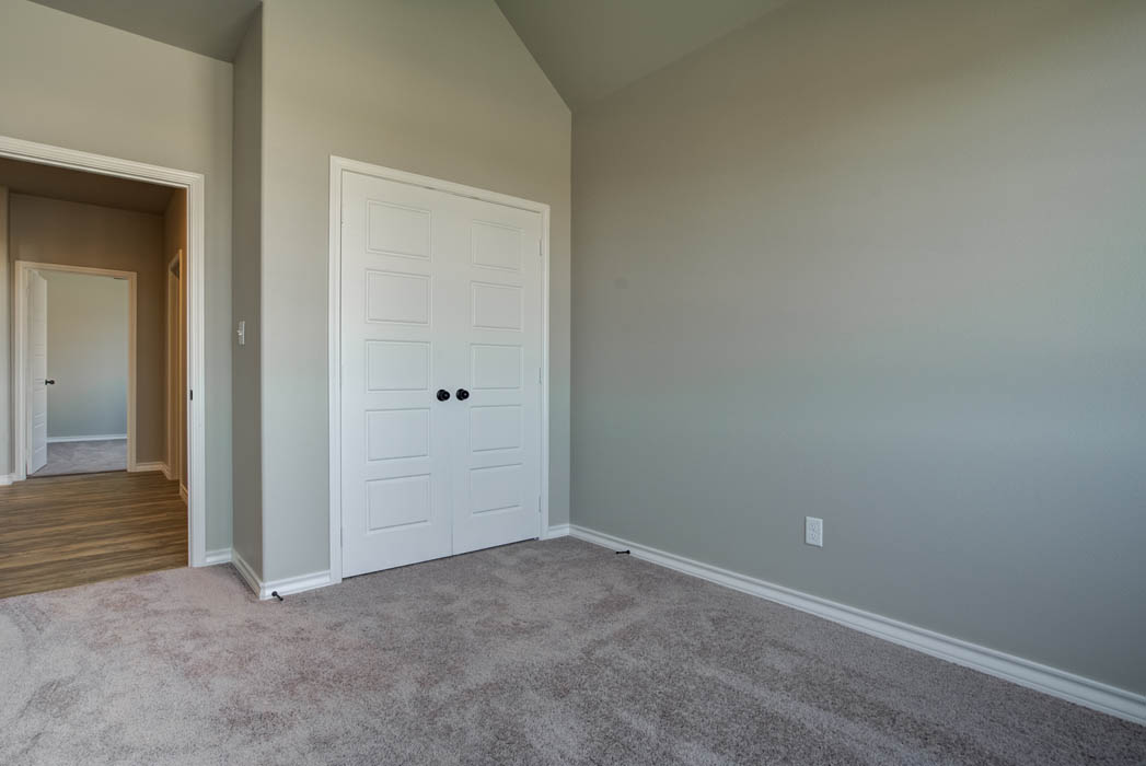 Guest bedroom in home for sale in Lubbock.