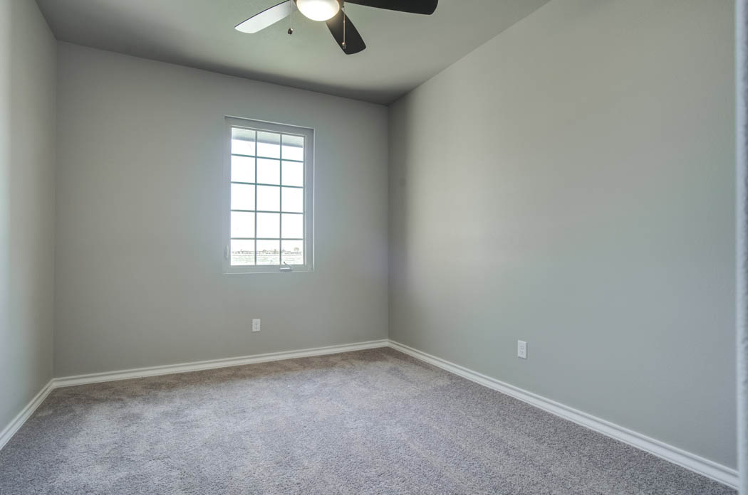 View of spacious bedroom in new home for sale in Lubbock, Texas.