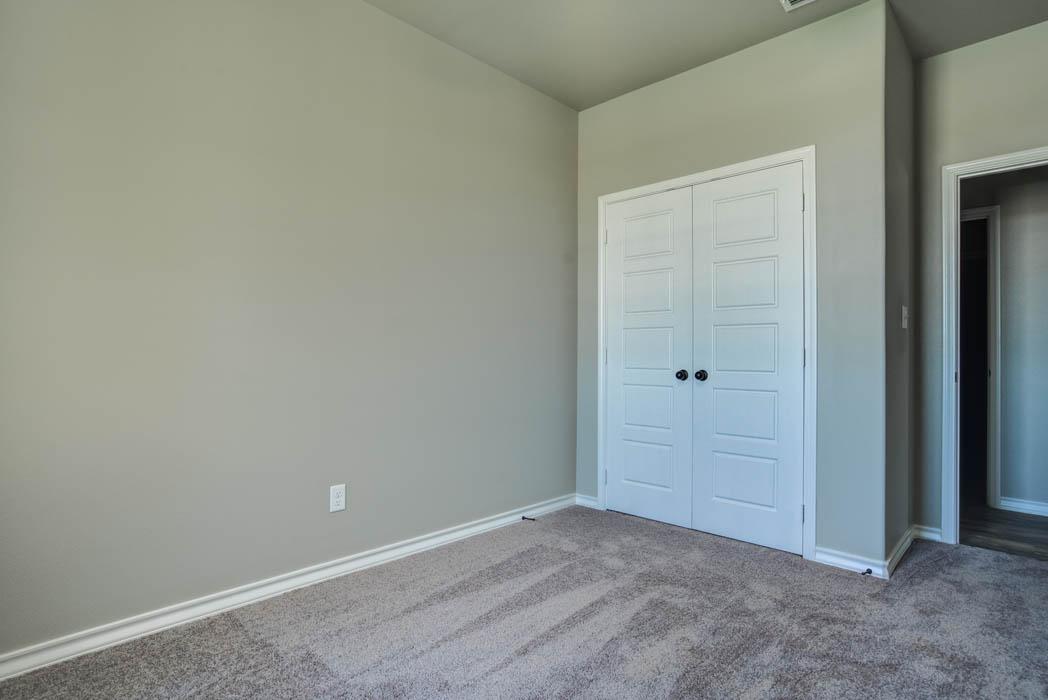 View of closet doors in beautiful bedroom in new home for sale in Lubbock.