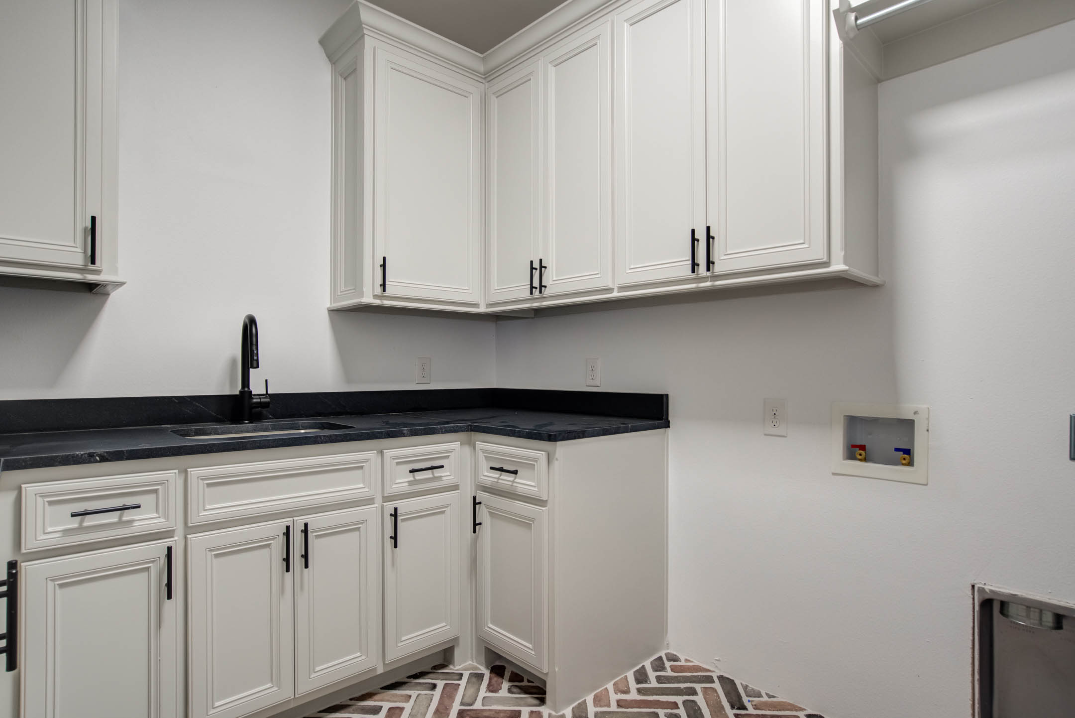 Laundry-mud room area in new home for sale near Lubbock.
