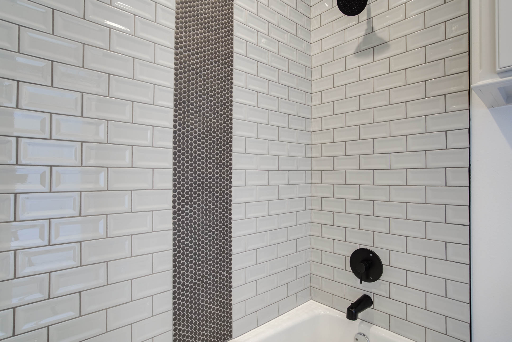 Detail of shower tile in master bath in new home for sale near Lubbock, Texas.
