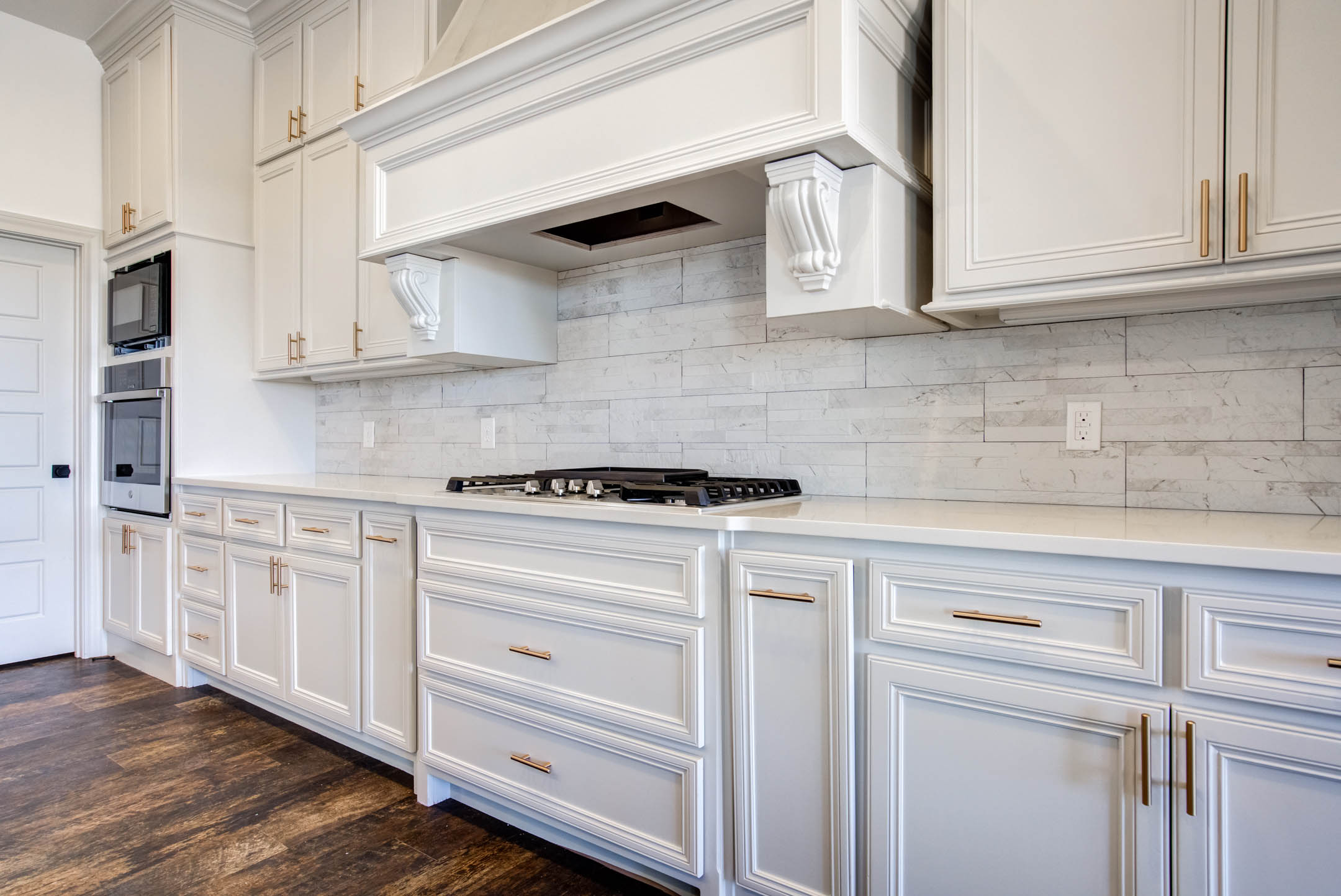 Stove area with beautiful tile treatment in kitchen of home for sale near Lubbock.