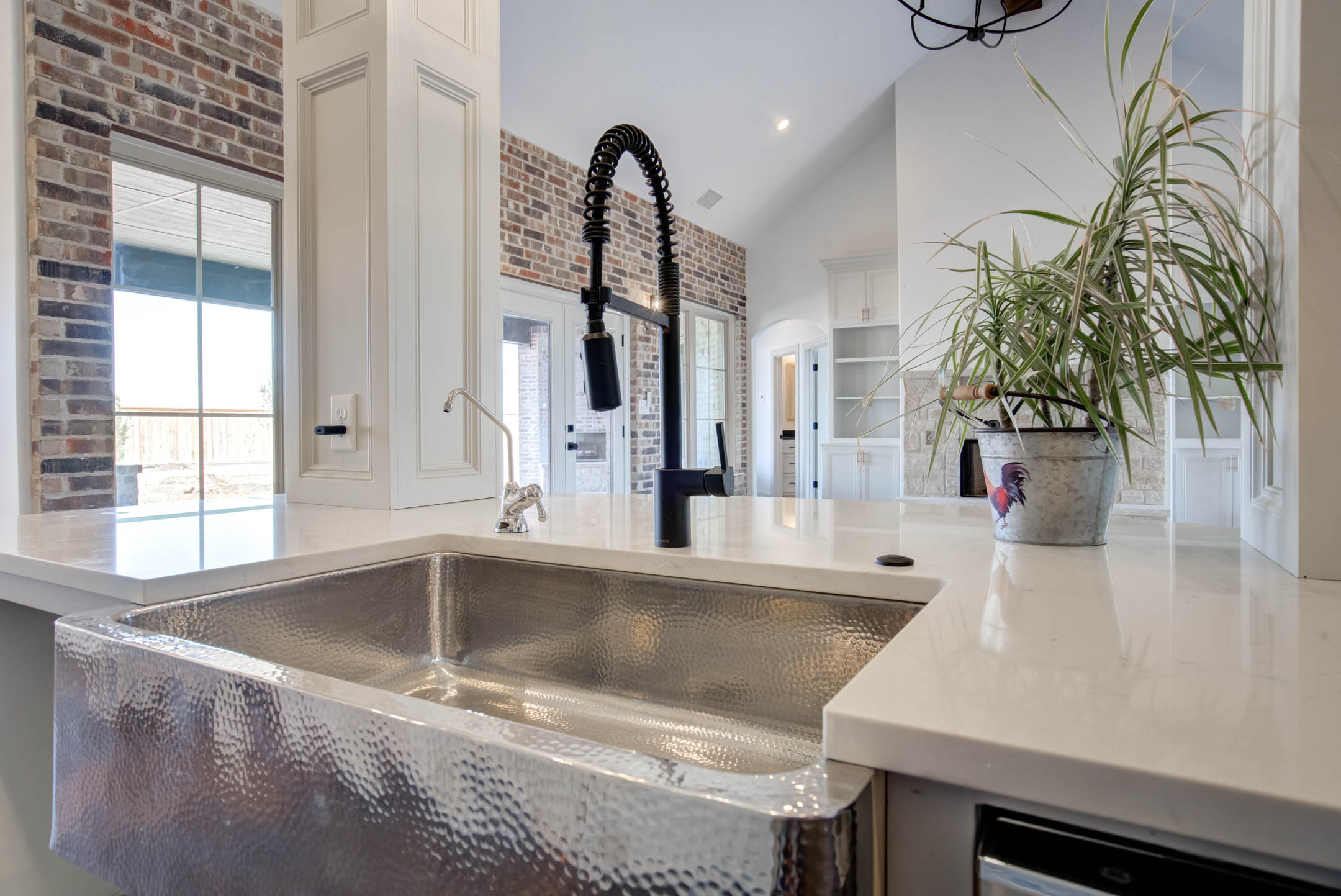 Detail of sink in beautiful kitchen in house at New Home, Texas.
