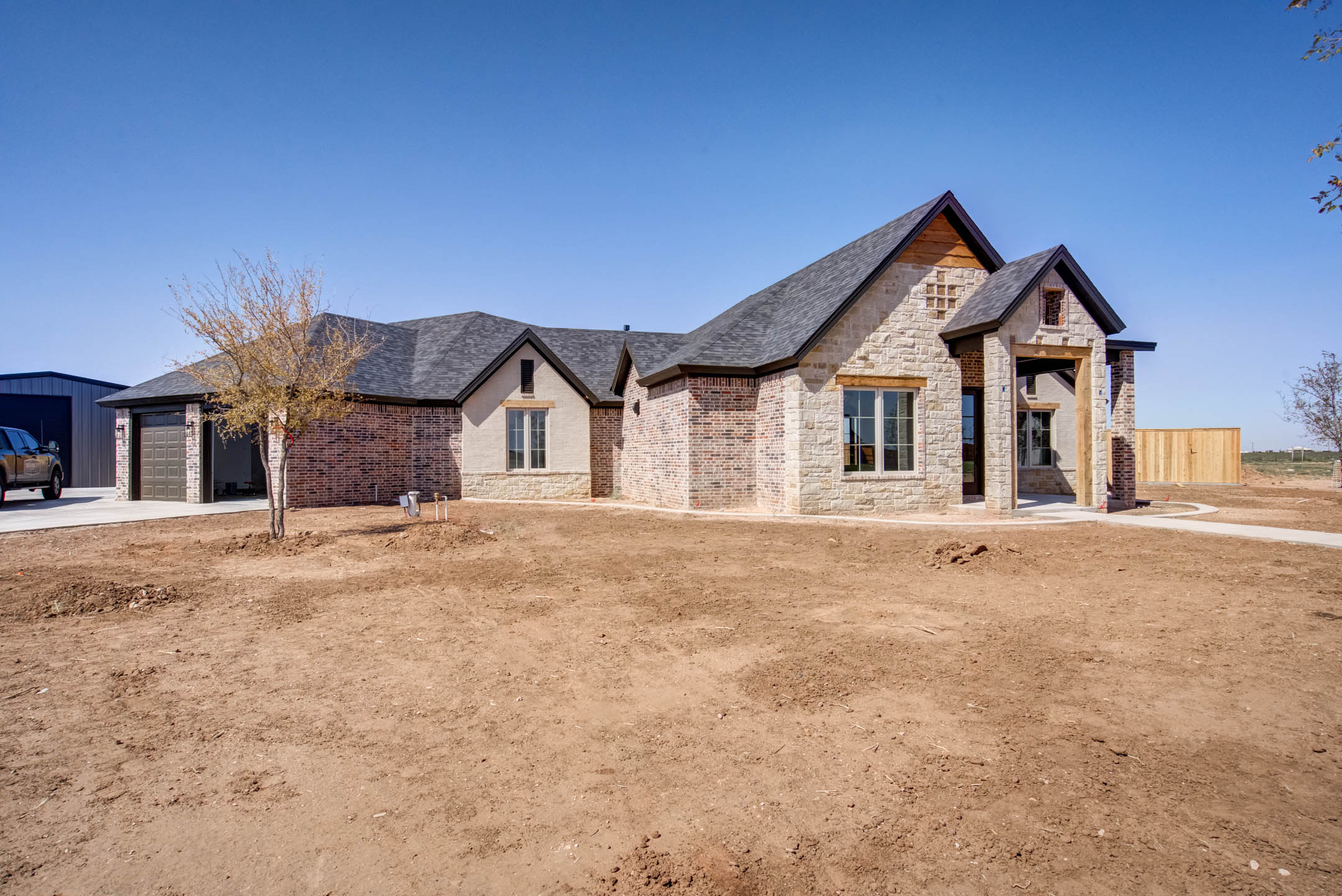 Exterior of beautiful new home for sale in New Home, Texas.