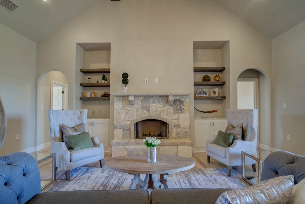 Fireplace and living area in new home for sale in Lubbock.