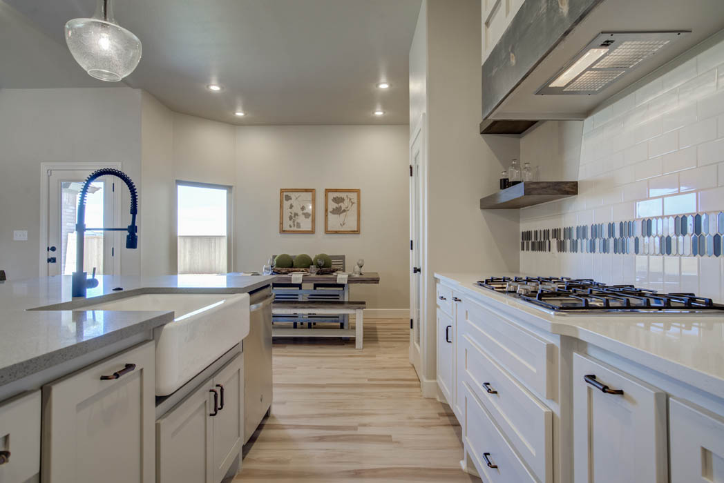 Detail of beautiful kitchen in new Lubbock, Texas home by Sharkey Custom Homes.