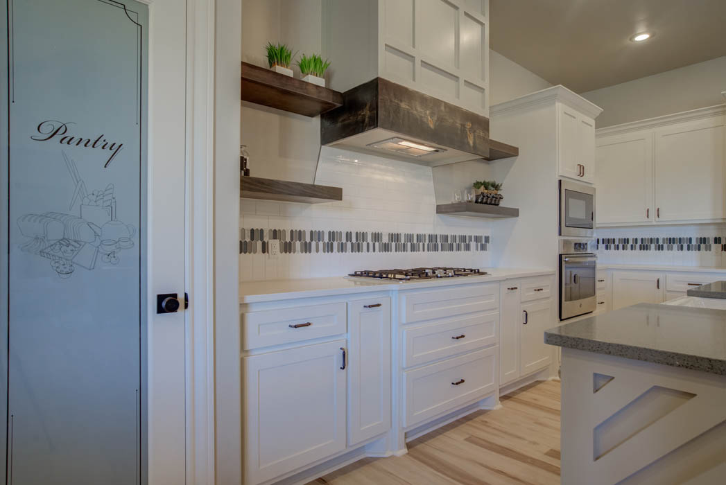 Detail of beautiful kitchen in new Lubbock, Texas home, showing stove.