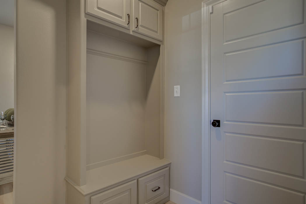 Laundry room in Lubbock home by Sharkey Custom Homes.