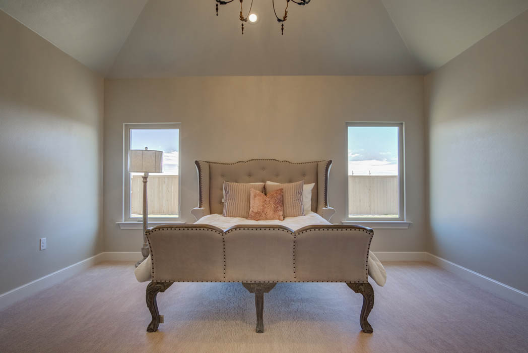 Beautiful master bedroom in new home in Lubbock, Texas.