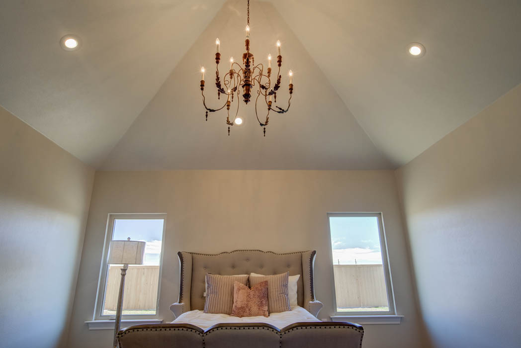 Master bedroom with beautiful ceiling treatment in new home in Lubbock, Texas.
