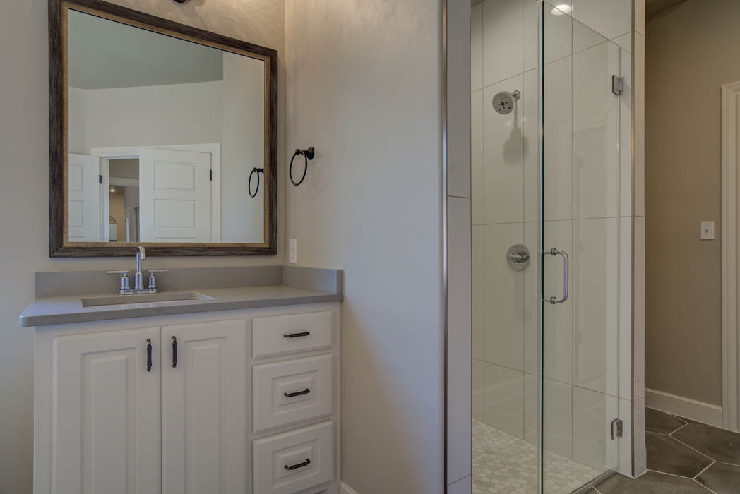 Vanity & shower in master bath of Lubbock, Texas home.