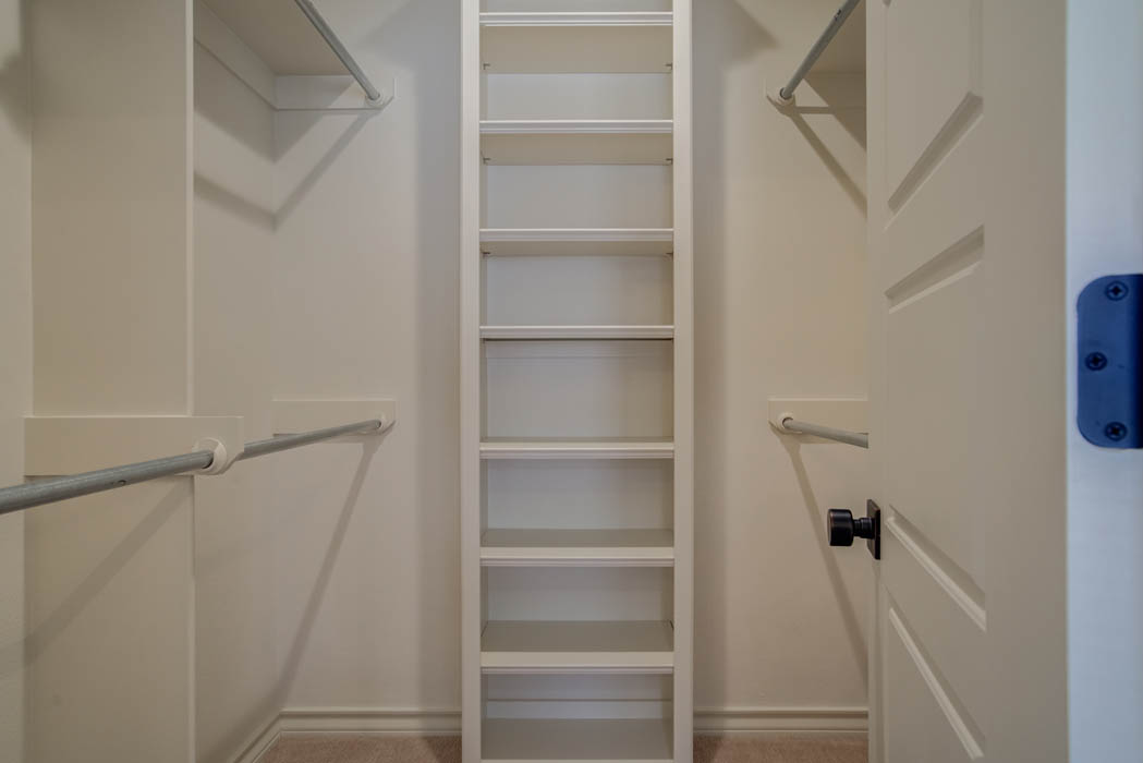 Spacious closet in master bedroom of Lubbock home.