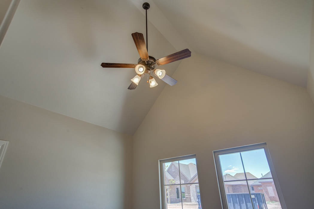Beautiful bedroom with vaulted ceiling in new home for sale in Lubbock, Texas.