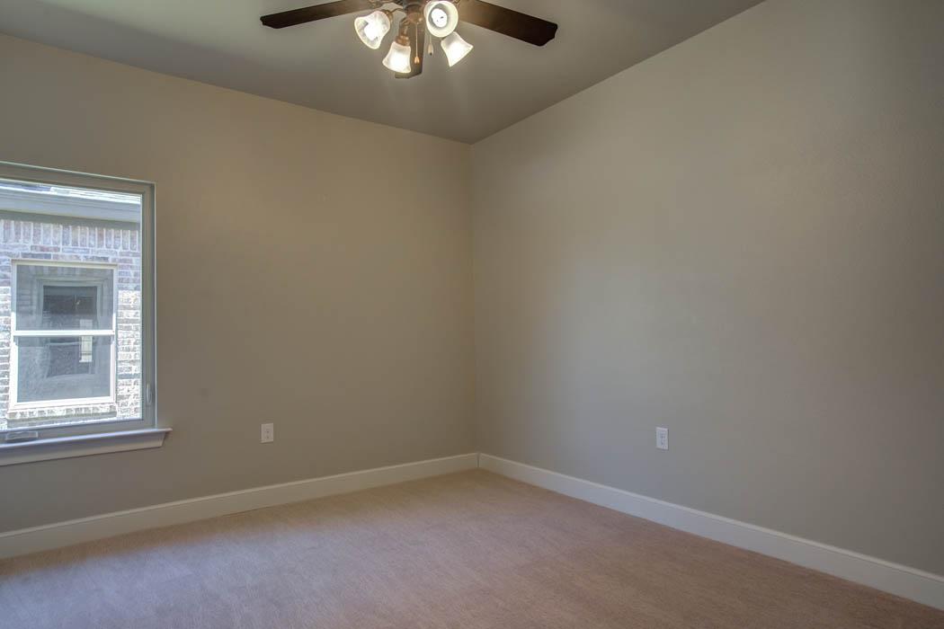 Spacious guest bedroom in Lubbock, Texas home.