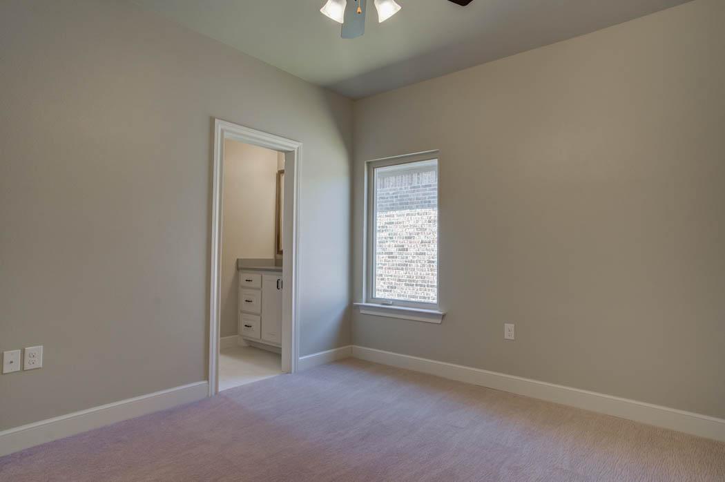 Guest bedroom in beautiful new Lubbock, Texas home.