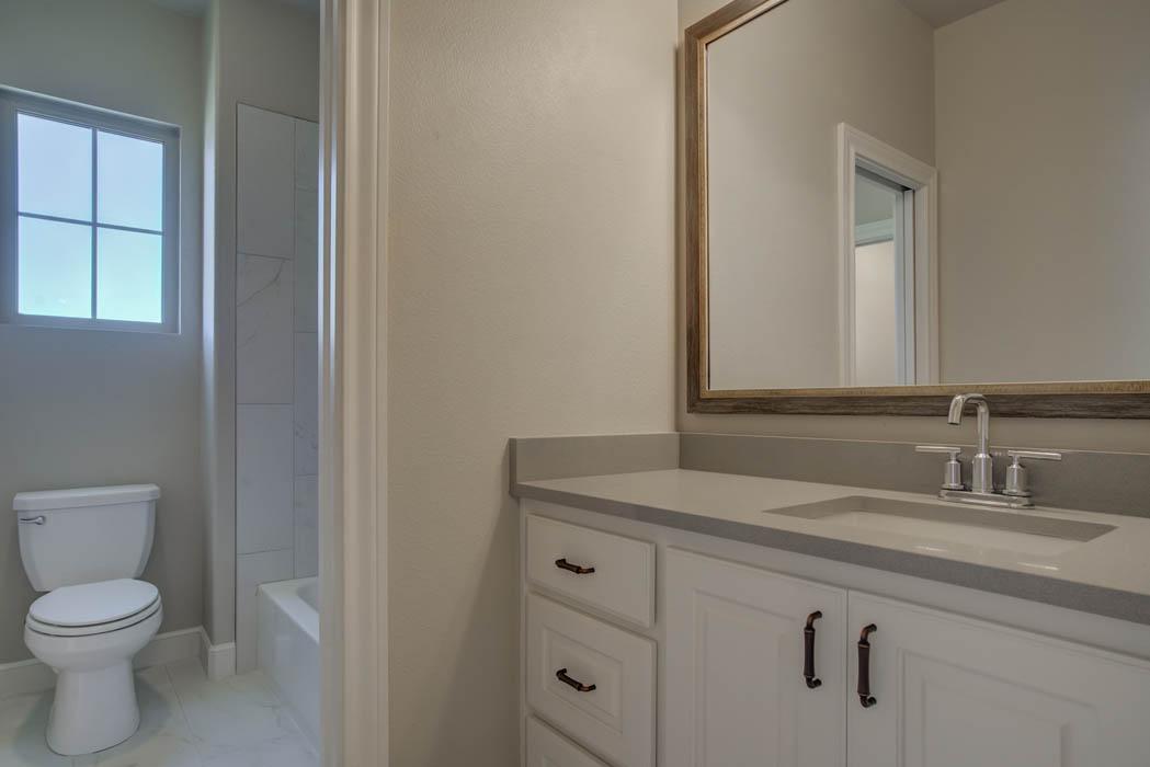 Spacious vanity in guest bath of Lubbock house.