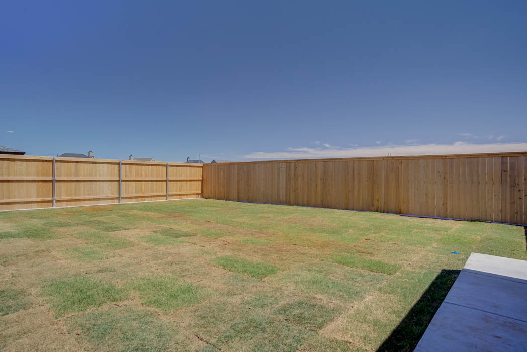 Spacious backyard in new Lubbock home by Sharkey Custom Homes.