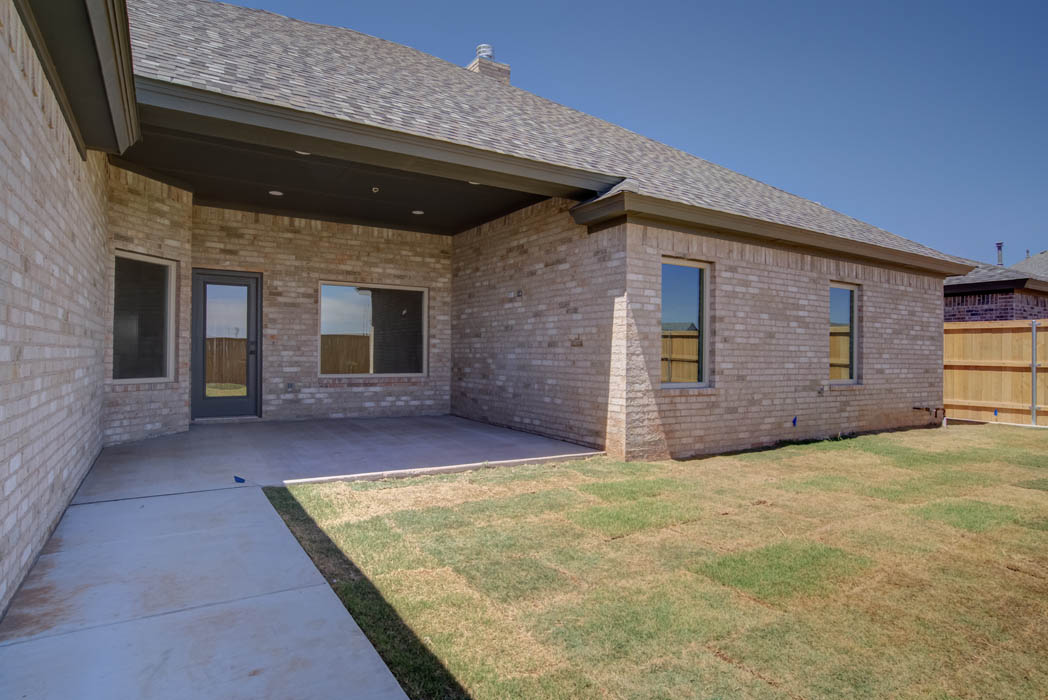Spacious patio in new Lubbock home by Sharkey Custom Homes.