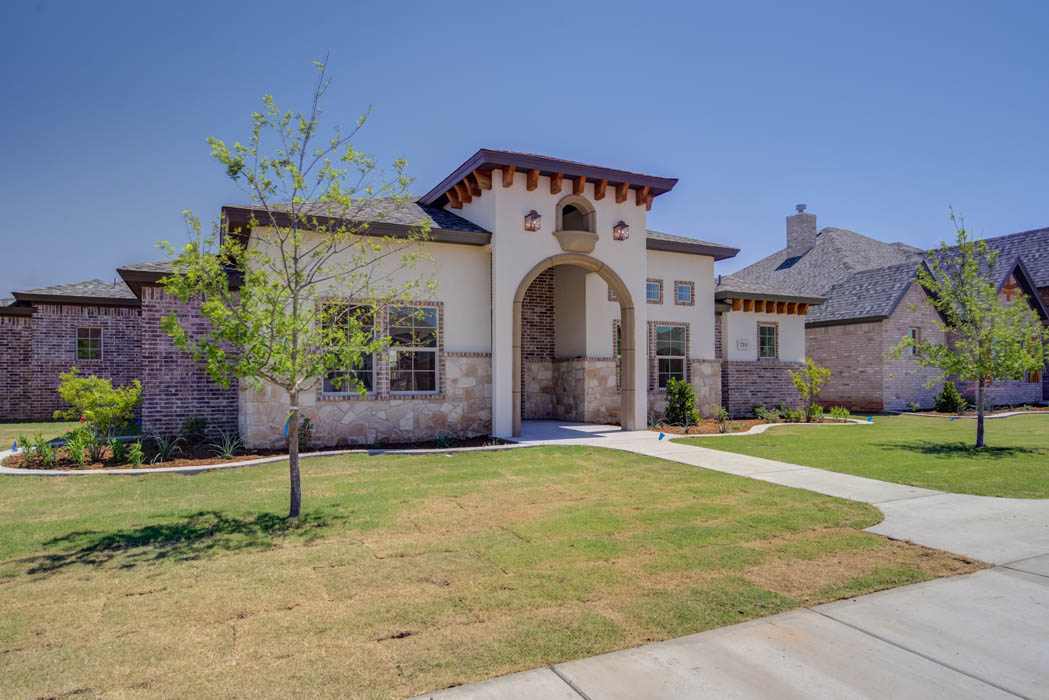 Great styling on exterior of home in Wolfforth, Texas by Sharkey Custom Homes.