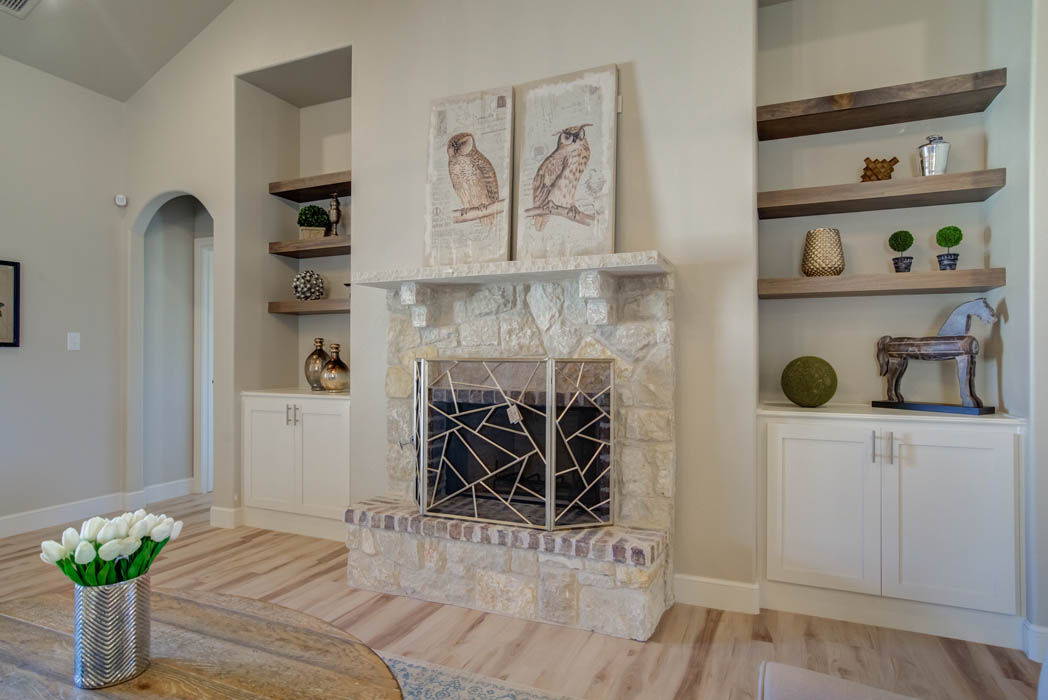 Fireplace and living area in new home for sale in Wolfforth, Texas.