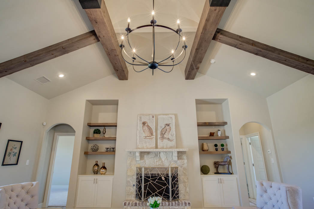 Beautiful living area with vaulted ceiling in new home for sale in Wolfforth, Texas.