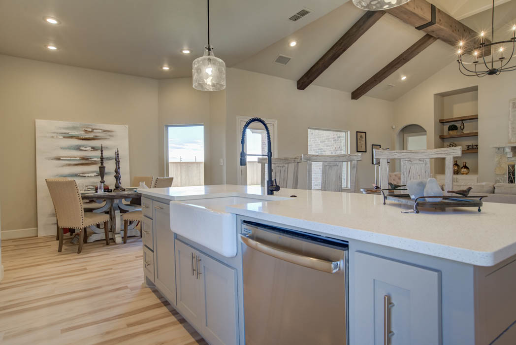 Spacious open-concept kitchen area in new home in Wolfforth, Texas.