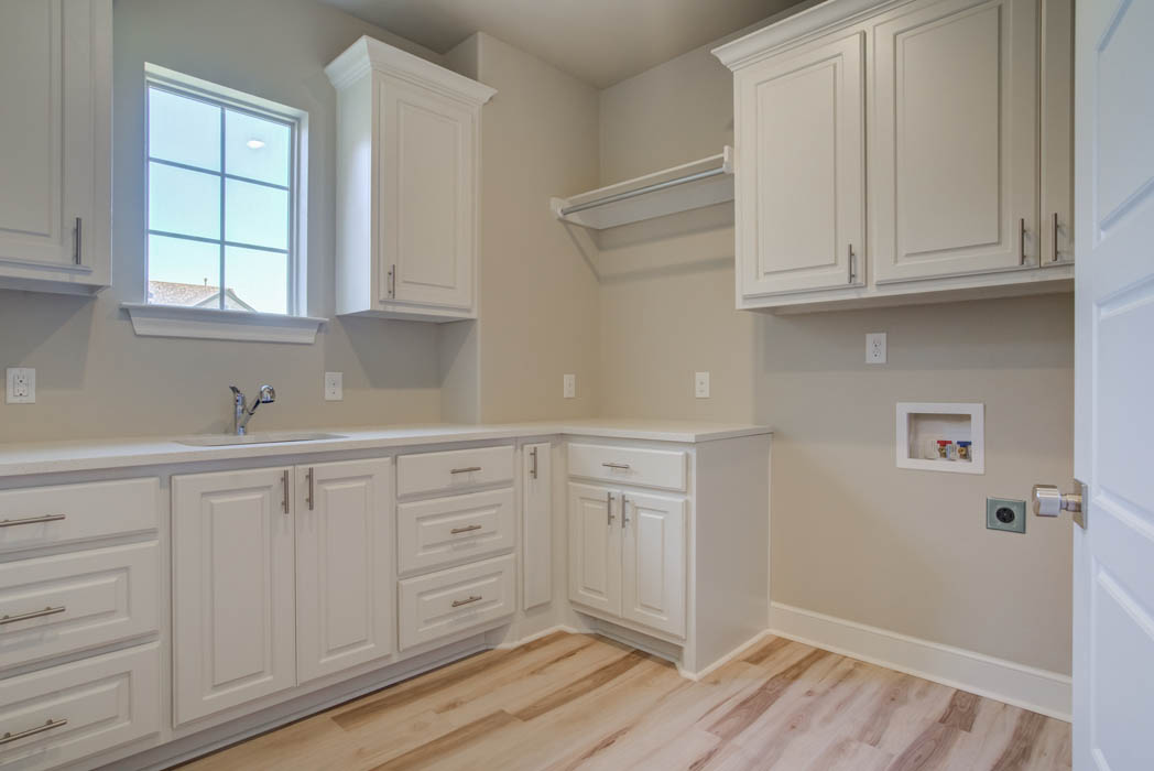 Spacious laundry room in new Wolfforth, Texas home for sale.