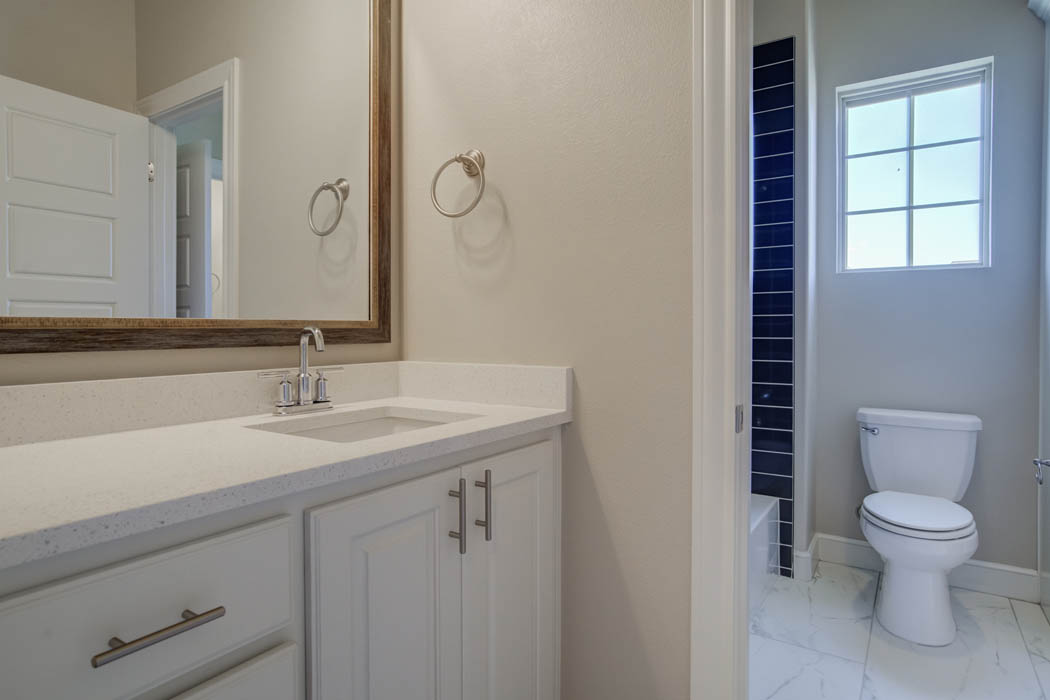 Spacious guest bathroom in Wolfforth, Texas home.