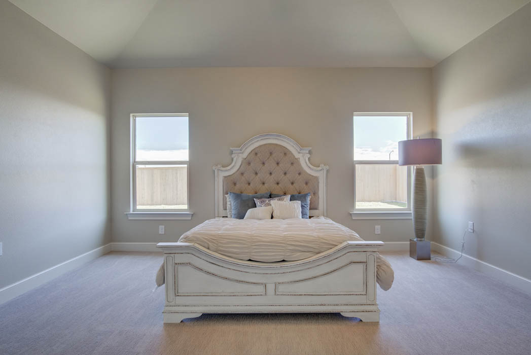 Master bedroom with beautiful ceiling treatment in new home in Wolfforth, Texas.