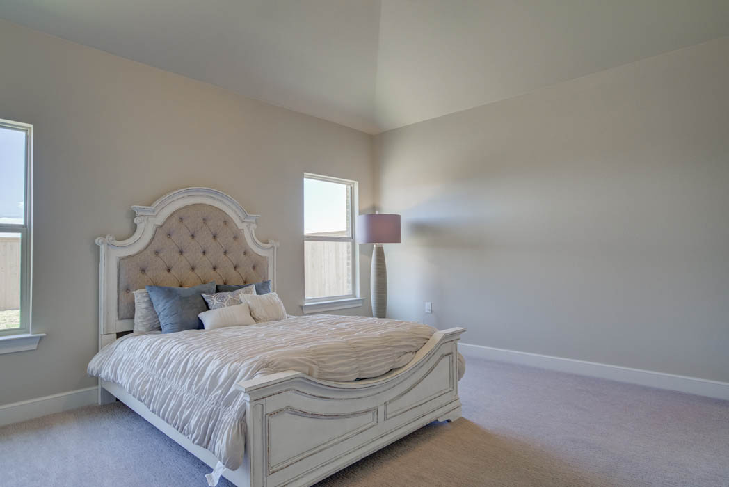 Spacious master bedroom of Wolfforth home by Sharkey Custom Homes.