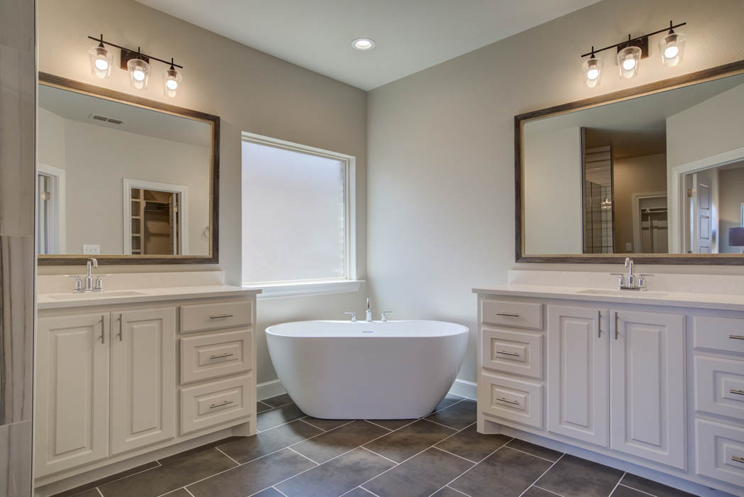 Spacious master bathroom of Wolfforth home by Sharkey Custom Homes.