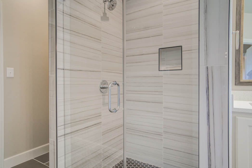 Detail of beautiful shower in new Wolfforth, Texas home by Sharkey Custom Homes.