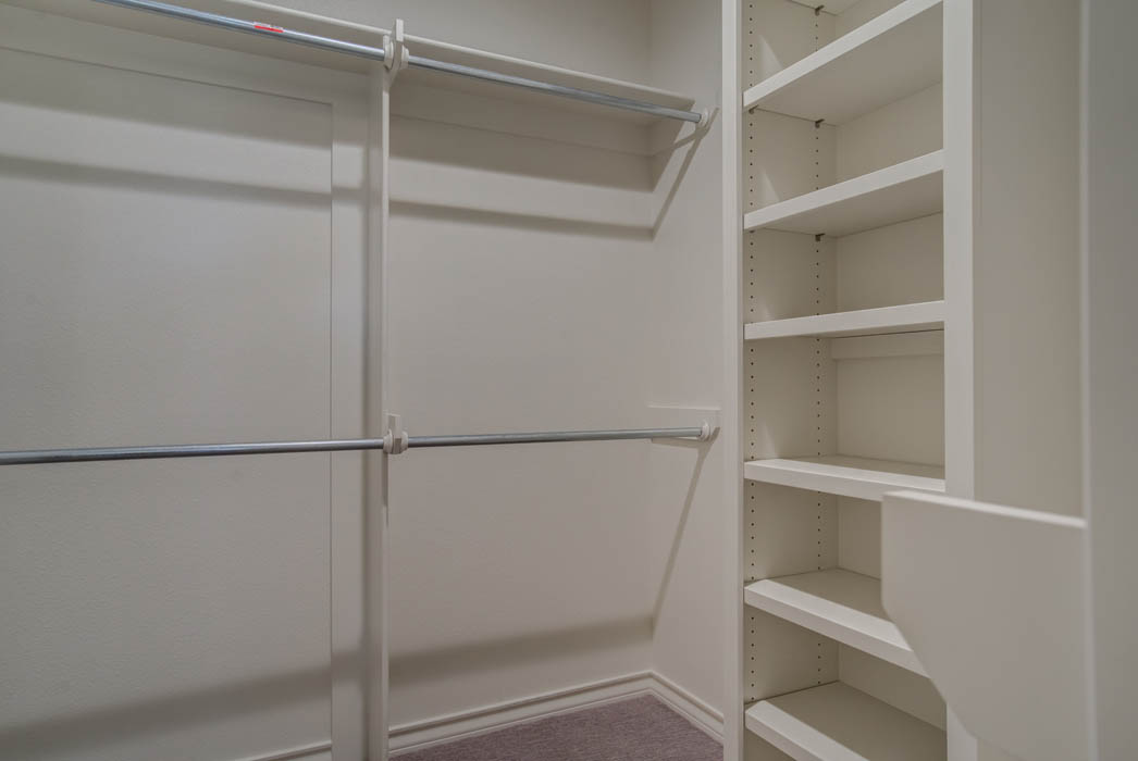 Spacious closet in master bedroom of new Wolfforth, Texas home.