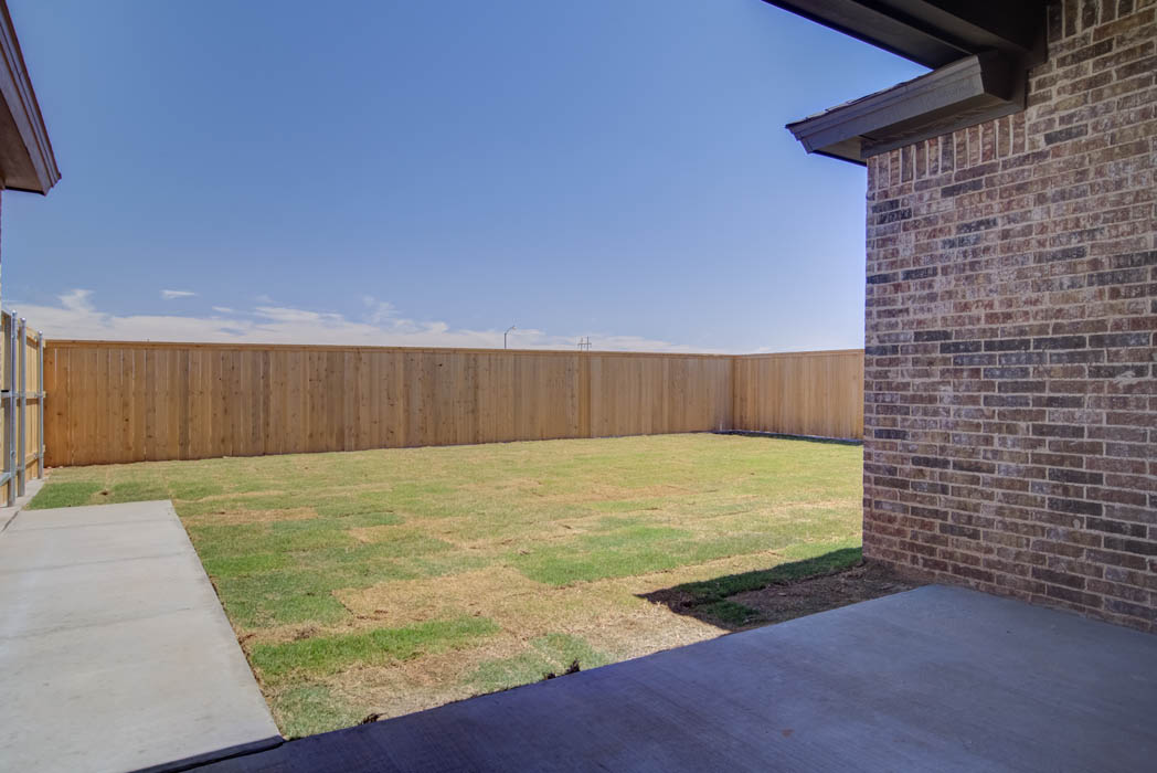 Spacious backyard in new Wolfforth home by Sharkey Custom Homes.