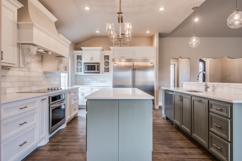Long view of spacious kitchen in custom Lubbock house by Sharkey Custom Homes.