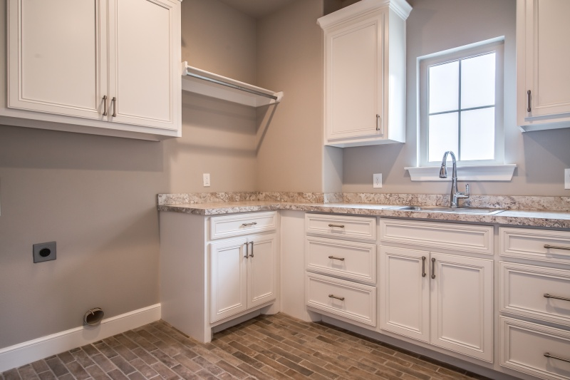 Spacious laundy room in custom home.