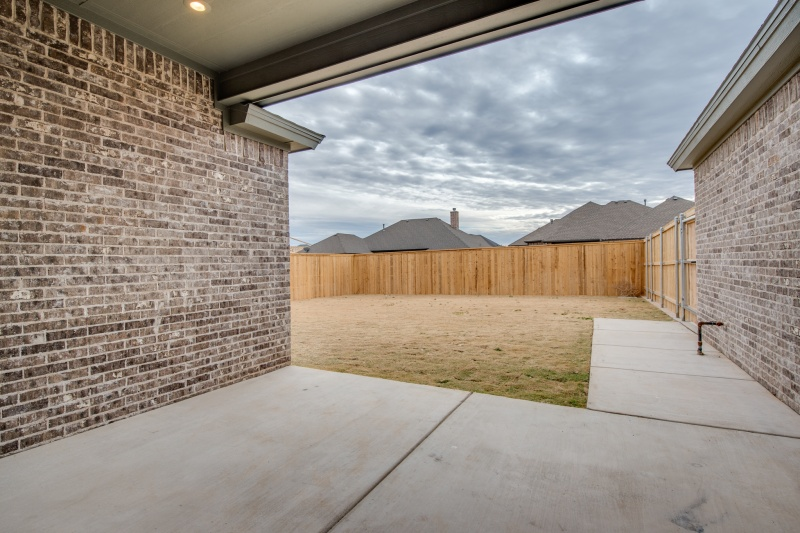Spacious backyard in Sharkey Custom Home.