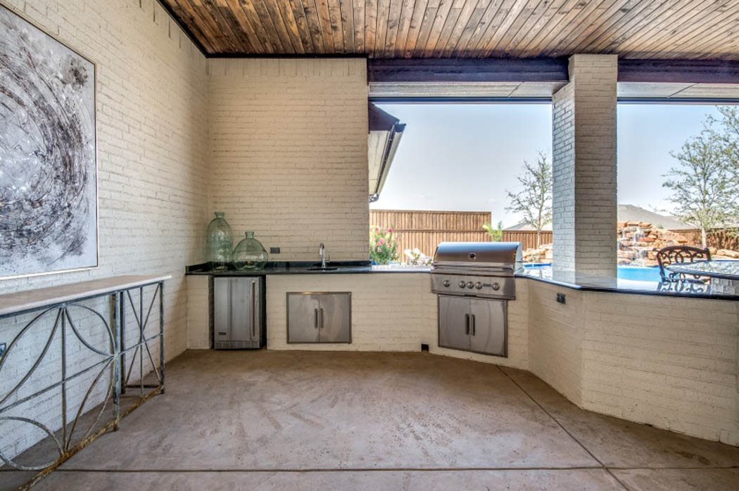 Detail of outdoor kitchen in house by Sharkey Custom Homes.
